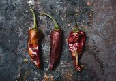 picture of chili peppers  - dried red chili peppers on dark background - JPG