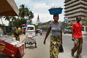 Tanzanian Black African Woman Carries Cargo On Your Head.