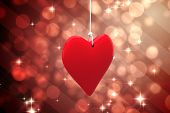 Red heart against light design shimmering on red