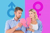 Couple holding two halves of broken heart against female gender symbol
