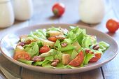 picture of smoked ham  - Caesar salad with grilled smoked ham and cherry tomatoes