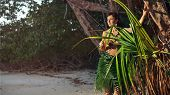 Indigene Woman In The Palm Skirt On The Tropical Forest Background