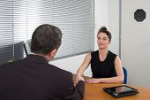 Business People Talking Together At Desk - Adviser And Customer