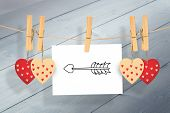 cupids arrow against bleached wooden planks background