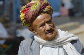 Portrait of man in a turban at the street in Taizz, Yemen.
