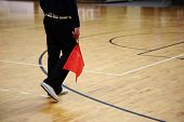 pic of volleyball  - Volleyball judge with a red flag on game court.
