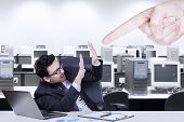 picture of pressure point  - Young businessman having problem in the office and bullied by someone - JPG
