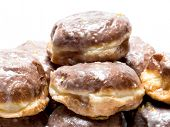 Pile of Polish donuts on white  background