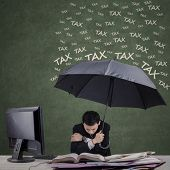 Man Using Umbrella For Hiding From Tax