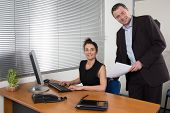 Boss  And His Secretary Working Together In The Office