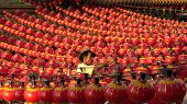 KUALA LUMPUR, MALAYSIA - FEBRUARY 08, 2015: An unidentified work hangs up hundreds of lanterns across the courtyard of the Thean Hou Temple in preparation for the coming lunar Chinese New Year.
