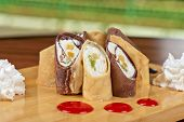 pancake roll with marmalade - dessert dish