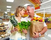 Senior shopping couple with grocery items . Healthy diet.