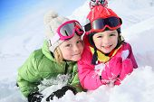 stock photo of family ski vacation  - Portrait of kids enjoying winter vacation at ski resort - JPG