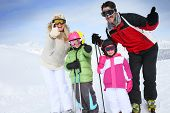 pic of family ski vacation  - Cheerful family at ski resort showing thumbs up - JPG