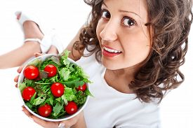 picture of youg  - Youg woman eating healthy salad isolated on white background - JPG