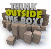 image of thinking outside box  - Think Outside the Box 3d words surrounded by cardboard boxes to illustrate original ideas - JPG