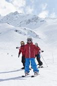 pic of family ski vacation  - Family On Ski Holiday In Mountains - JPG