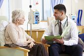 pic of chemotherapy  - Woman Having Chemotherapy With Doctor Looking At Notes - JPG