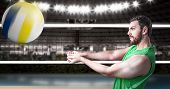 picture of volleyball  - Volleyball player on green uniform in volleyball court - JPG
