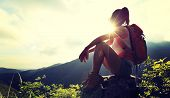 picture of cliffs  - woman backpacker enjoy the view at mountain peak cliff - JPG