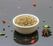 stock photo of cumin  - Cumin seeds in the bowl on black background for decorate and design project - JPG