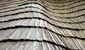 pic of shingles  - The old wooden shingle roof. Close up.