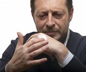 foto of noah  - Man puts hand cream on his hands - JPG