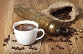 foto of coffee crop  - Coffee beans white cup with a coffee drink and coffee grinder - JPG