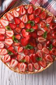 stock photo of tarts  - homemade tart with fresh strawberries mint and cream cheese on a table close - JPG