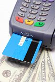 stock photo of terminator  - Payment terminal with credit card and money on white background credit card reader payment terminal with cash finance concept - JPG
