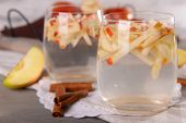 foto of cider apples  - Glasses of apple cider with fruits and cinnamon on table close up - JPG