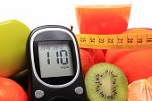 stock photo of immune  - Glucose meter fresh fruits with tape measure glass of juice and green dumbbells for fitness concept for diabetes slimming healthy nutrition and strengthening immunity - JPG