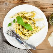 stock photo of pesto sauce  - Cooked homemade tagliatelle pasta with green pesto sauce - JPG