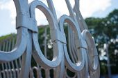 picture of metal grate  - fragment of white metal grating on sunny day - JPG