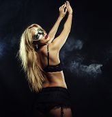 image of stripping women window  - young sexy woman in black lingerie wearing mask - JPG