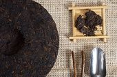 image of briquette  - Chinese Puer tea pressed into rounded briquettes - JPG