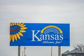 picture of kansas  - a welcome to kansas state road sign