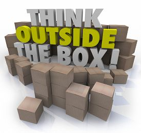 foto of thinking outside box  - Think Outside the Box 3d words surrounded by cardboard boxes to illustrate original ideas - JPG