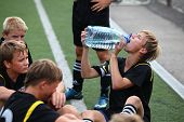 Football players drink water on time-out