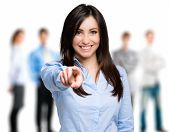 Smiling woman pointing her finger to you poster