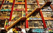 Stairs on a building covered in graffiti