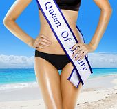 pic of beauty pageant  - part of woman shape of beautiful thigh in bikini with white tape of beauty contest - JPG