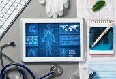 White Tablet Pc And Doctor Tools On Gray Surface poster