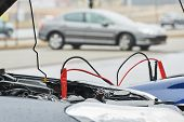 Automobile help. booster jumper cables charging automobile discharged battery poster
