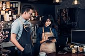 Asia Barista Waiter Take Order From Customer In Coffee Shop,cafe Owner Writing Drink Order At Counte poster