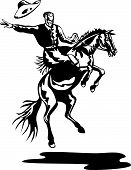 pic of bronco  - Vector art of a Rodeo cowboy riding a bucking bronco - JPG