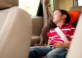 Ltitle Boy Sleeps In Safe Chair In Car