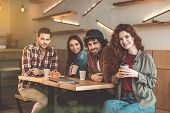 Enjoying Time With Best Friends. Portrait Of Happy Young Men And Women Drinking Coffee In Cafe. They poster