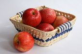 Red Apples In Straw Basket